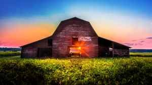 Growing Our Future US report cover featuring an American style barn, photographed during sunset